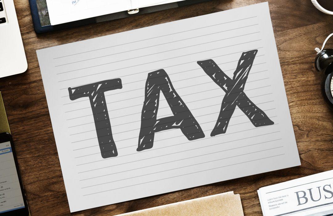 Tax word written on paper